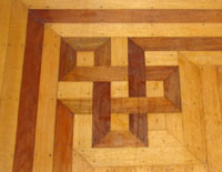 inlaid walnut floors in the music and breakfast parlors